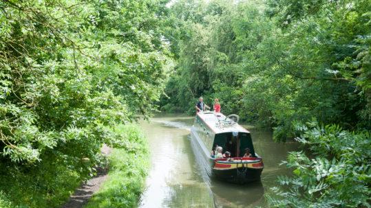 Narrowboat with family on holiday